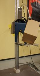 Drop tester to simulate shocks to packaged product from material handling during shipment